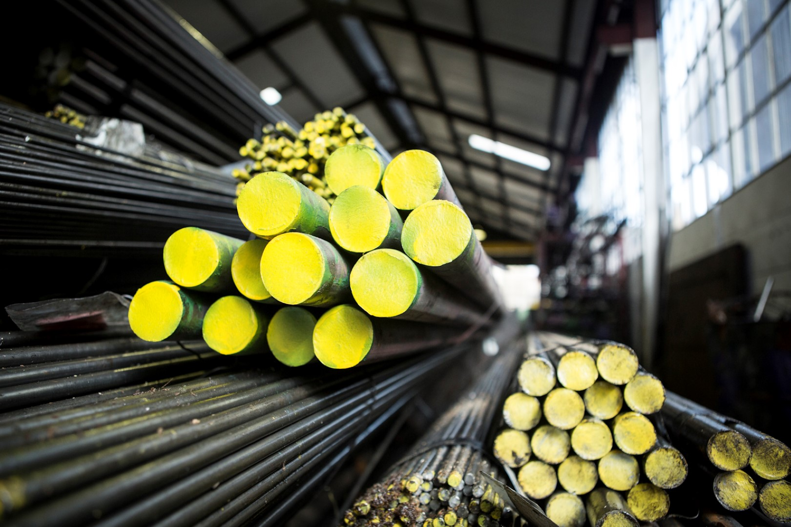 EN8 High tensile steel raw material used to make threaded products (painted yellow)
