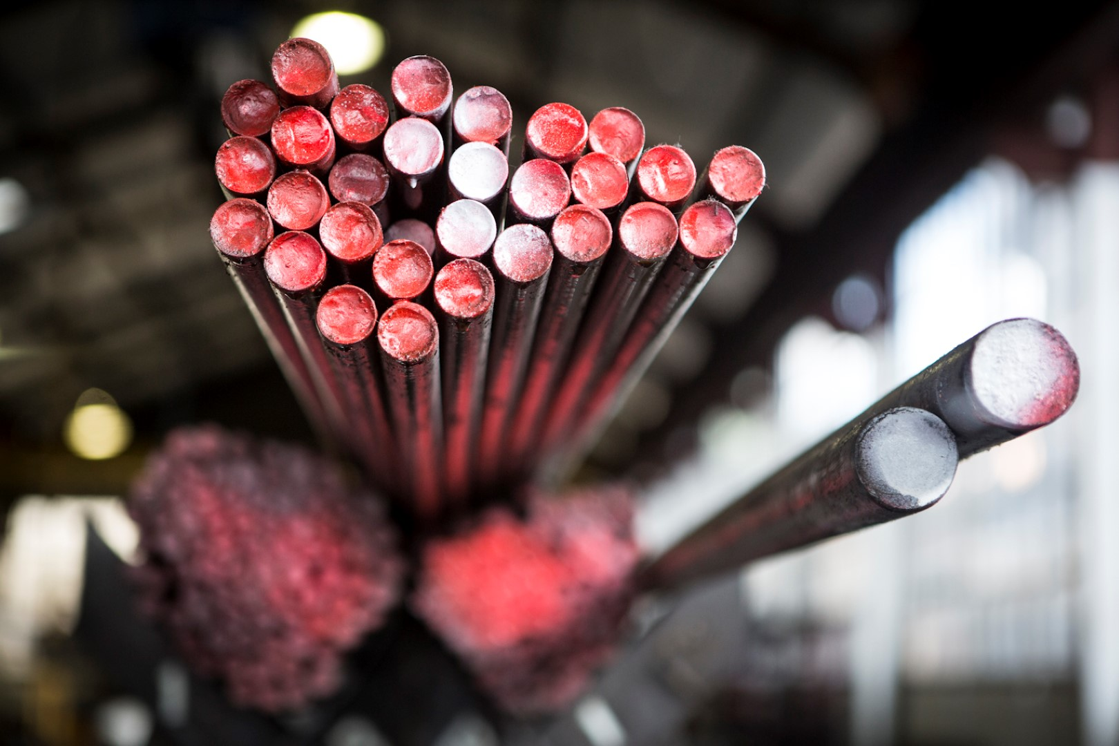 Mild steel raw material used to make threaded products (painted red)